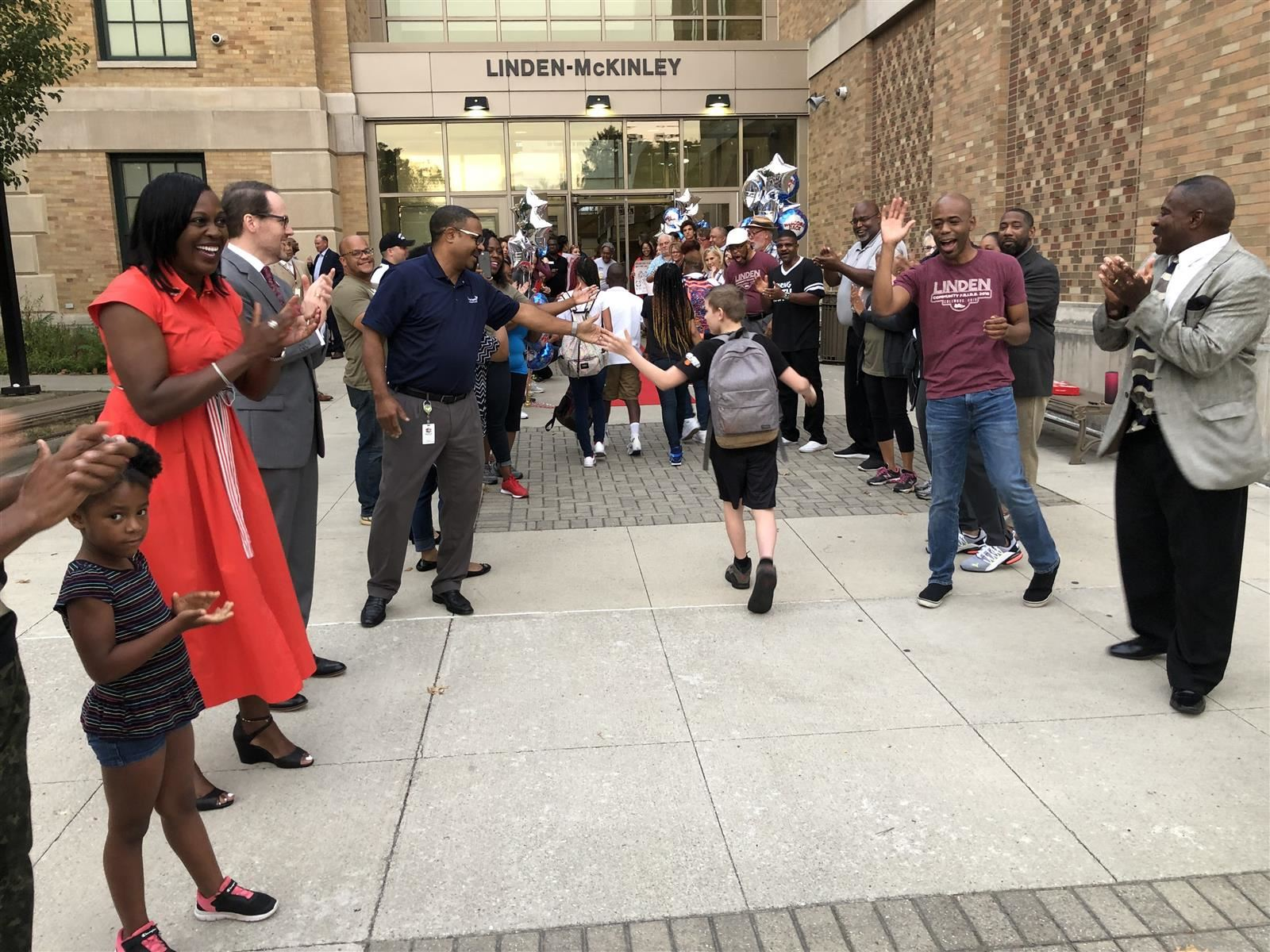 Columbus Schools Superintendent Talisa Dixon, second from left, welcomes students back to school