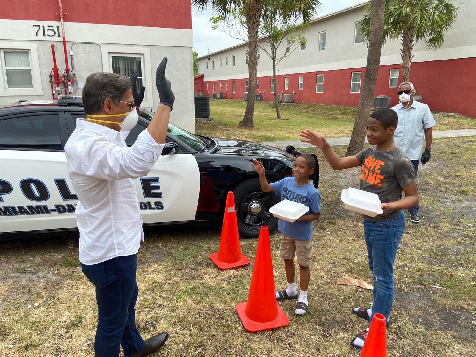 Miami School Superintendent Alberto Carvarlho interacts with students during the district's community feedings.